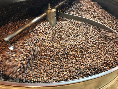 Coffee beans are cooled in special equipment after roasting. Special blades mix coffee beans. Background. Texture. Stockfoto