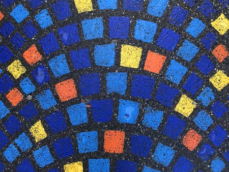 Top view of the asphalt pavement with painted multicolored rectangles. The rectangles are arranged in an arc in several rows. Background. Texture.