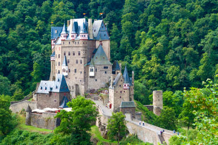 castle buildings: Eltz Castle, a medieval castle located on a hill in the forest Editorial
