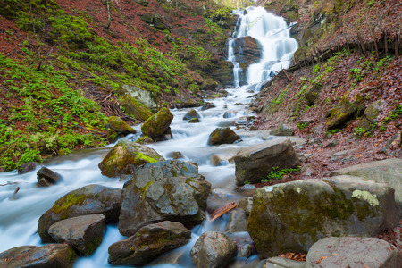 Landscape with waterfall Shipot and forest river among the rocks in the woods. Carpathians. photo