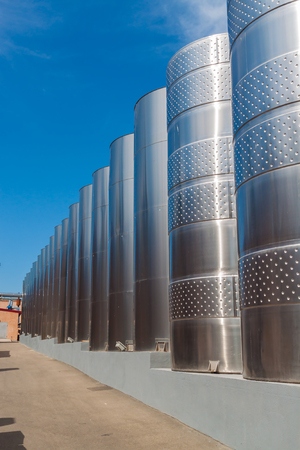 maturing: Modern metal tanks for maturing and cooling wine standing in  line Stock Photo