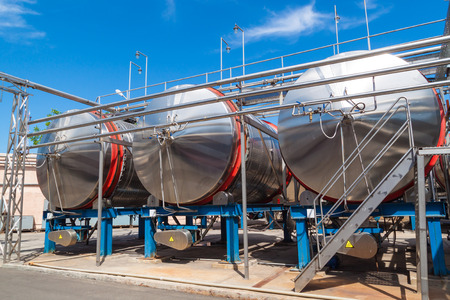 horizontal position: Modern metal tanks for maturing and cooling wine in a horizontal position. Stock Photo