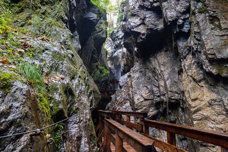 kaprun: A wooden bridge along a vertical cliff over the abyss. Austria, Kaprun.