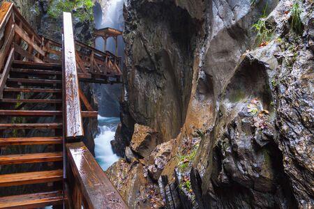 kaprun: A wooden bridge over the rough river, Austria, Kaprun