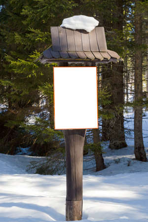 wooden post: Rectangular signboard  on  wooden post in the winter forest Stock Photo