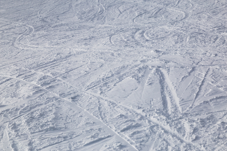 ski traces: Traces from skiing on white snow close-up. Ski slopes. Stock Photo