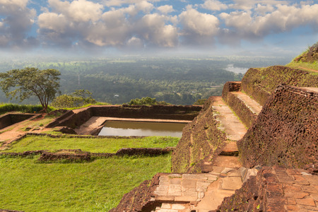 heritage protection: Ancient palace of Sigiriya in Sri Lanka against  background of white clouds