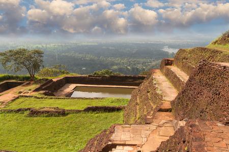 sigiriya: Ancient palace of Sigiriya in Sri Lanka against  background of white clouds