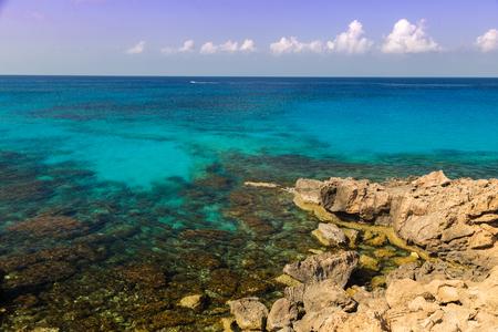 Seascape with azure sea and rocks , coast of the Mediterranean Sea at sunny summer day. Coast of Cyprus, Ayia Napa.