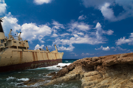 aground: Shipwrecked boat near the rocky shore aground. Mediterranean Sea, near Paphos. Cyprus