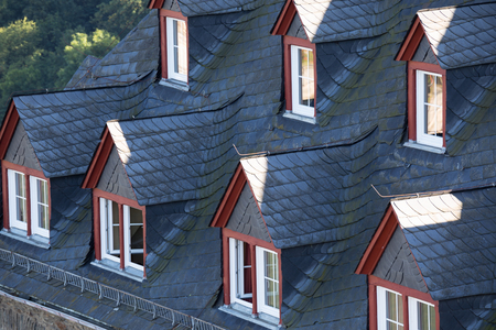 many windows: Ceiling mansard roof of  house with many windows closeup Stock Photo