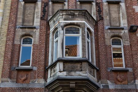 bow window: Bay window on  facade of ancient  brick house  in Gent. Belgium.