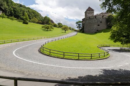 princes street: Winding road leading to the castle  Vaduz, Principality of Liechtenstein at sunny summer day