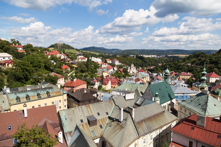 Ancient city  Banska Stiavnica, Slovakia, UNESCO World Heritage site. Panorama of town on the background of  cloudy blue sky. Top view.