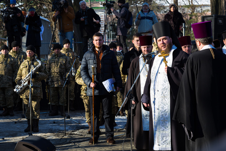 January 22, 2017: Ukraine. City Dnipro (Dnipropetrovsk). Celebration of  Day of Unification of Ukraine - the reunification of Ukrainian and Western Ukrainian Peoples Republic. Opening of monument. Consecration of  Monument to the priests of  Ukrainian Or