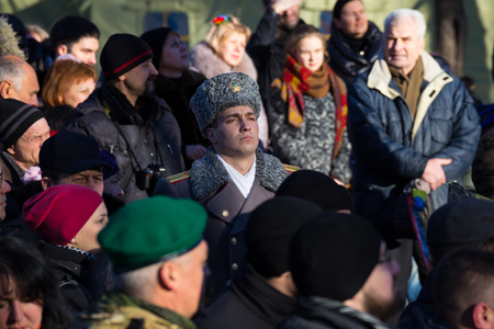 January 22, 2017: Ukraine. City Dnipro (Dnipropetrovsk). Celebration of  Day of Unification of Ukraine - the reunification of Ukrainian and Western Ukrainian Peoples Republic. Opening of  monument. Man of  military honor guard in dress uniform among peop