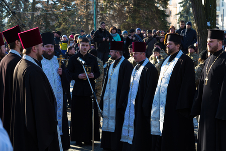 January 22, 2017: Ukraine. City Dnipro (Dnipropetrovsk). Celebration of  Day of Unification of Ukraine - the reunification of Ukrainian and Western Ukrainian Peoples Republic. Opening of monument. Consecration of  Monument to  priests of the Ukrainian Or