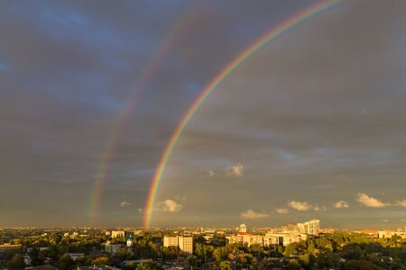 Rainbow over big industrial town - the urban landscape,  top view. Dnipro. Ukraine.