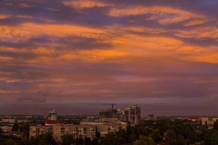 fantastic orange sunset  over the big industrial city - urban landscape. Dnipro. Ukraine.