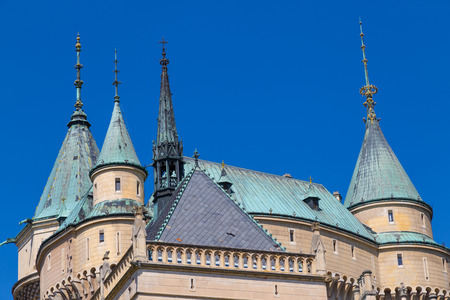 impregnable: Сastle Bojnice, Slovakia. Tourist destination. Dome and tower of  roof close-up against a blue sky