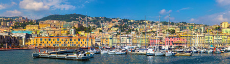 Panoramic view of the port  Genoa ( Genova ), Italy. View from the sea to the old town on  summer sunny day. Genoa bay, harbor, yacht at the pier.  Center of the Ligurian Riviera.Tourist destinations