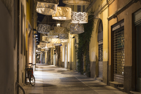Ancient street lit by original lamp in the form of  shade at night, city  Parma, Emilia-Romagna province , Italy. Europe. Famous place of tourist destination. City of creative gastronomy under the auspices of UNESCO