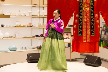 entertainment center: February 21, 2016: South Korea, Incheon International Airport. Traditional cultural experience center, passenger terminal - girl in national costume sings a song