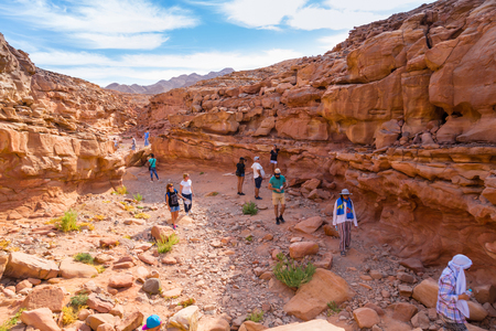 sinai desert: Coloured canyon, Sinai desert, Egypt, 10.24.2017 - tourists from all over the world are traveling through the gorge. Famous tourist site. Concept  active  lifestyle