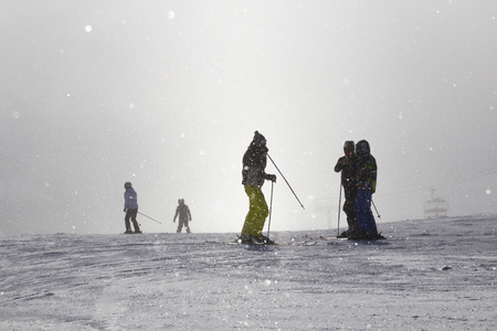 Skiers on ski slope, chairlift in the fog. Strbske Pleso. High Tatras  Mountains. Slovakia. Winter sport. Concept of leisure, active healthy lifestyle, winter entertainment