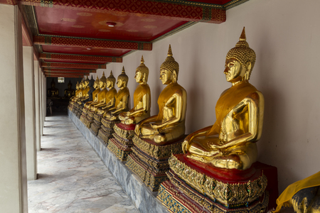 Wat Pho . Temple of the Reclining Buddha. The courtyard. Gilded Buddha statues. Bangkok. Thailand. Famous tourist destination, tourist attraction.