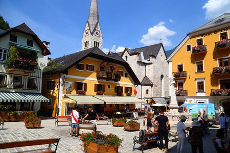 06. 08.2018 : HALLSTATT, AUSTRIA - small mountain village,  Salzkammergut Cultural Landscape, one of the World Heritage Sites in Austria. Streets of old town are full of tourists from all over the world. Famous tourist destination, tourist attraction, bea Editorial