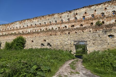 Ancient wall against the blue sky. Stare Selo castle. Fortress in Stare Selo, Lviv region. Ukraine. Tourist destination, landmark