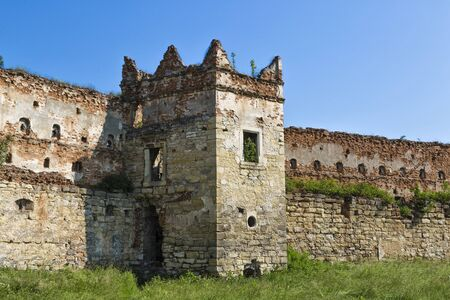 Ruins of Stare Selo castle, wall and tower against the blue sky. Fortress in Stare Selo, Lviv region. Ukraine. Tourist destination, landmark Banco de Imagens