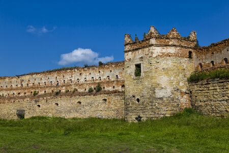 Medieval Citadel. Ruins of Stare Selo castle, wall and tower against the blue sky. Fortress in Stare Selo, Lviv region. Ukraine. Tourist destination, landmark Banco de Imagens