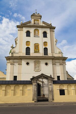 Old Dominican Monastery , church of St. Josaphat on cloudy sky background, main entrance, facade elements. Ancient historical city  Zhovkva,  Lviv region, western Ukraine. Tourism destination, torist landmark Banco de Imagens