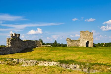 Ruins of the ancient Kremenets Castle, fortess. Stone citadel on a cloudy blue sky background. City Kremenets. Ukraine. Tourist destination, landmark Banco de Imagens