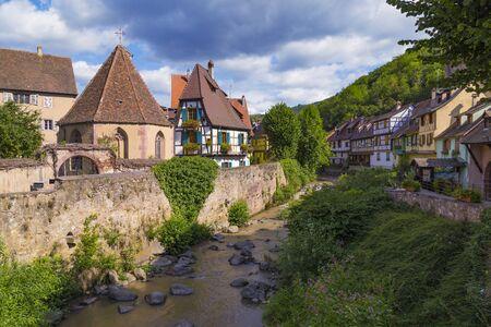 Picturesque medieval town. Colorful houses along the river. Village Kaysersberg. Alsace wine route. France. Tourism destination, tourist landmark.