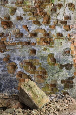 Picturesque multi-colored ruined brick wall inside the building. Ruin. Abstract background Stock Photo