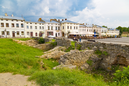 06.06.2019 Ancient historical city Zhovkva was built on an ideal Renaissance city plan, Lviv region, Ukraine. Central square with archaeological ruins of old town at summer day. Tourism destination, travel