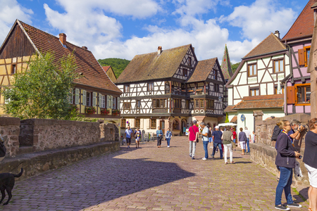 14.08. 2019. Small town Kaysersberg, region Alsace. France. Colorful  street of medieval centre at summer. Tourism on the Alsace Wine Route. Famous tourism destination, tourist attraction.