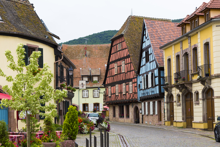 Ancient small wine town  Kientzheim on the Alsace Wine Route, winemaking region. France. Colorful  street of medieval centre at summer. Tourism destination, tourist attraction.