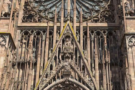 Elements of top part of west facade of the ancient Strasbourg Cathedral close-up. Medieval architecture. Alsace.  France. Imagens