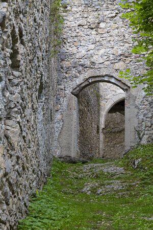 Old ruined Gallenstein Castle, narrow entrance to the stone citadel. Municipality of Sankt Gallen,  Styria, Austria. Tourist landmark