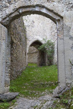 Old ruined Gallenstein Castle, narrow entrance to the stone citadel. Municipality of Sankt Gallen,  Styria, Austria. Tourist destination Standard-Bild
