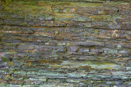 Multicolored textured natural stone surface of rock. Stone pattern abstract background. Rock structure.