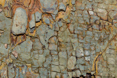 Brown and gray colored textured natural stone surface of rock. Stone pattern abstract background. Rock structure outdoor. Standard-Bild