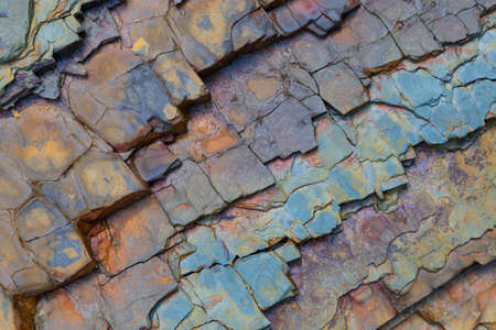 Volumetric colored textured natural stone surface of rock. Stone pattern abstract background. Rock structure outdoor.