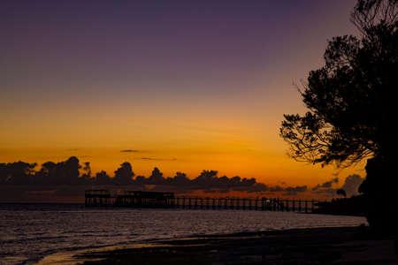 Sunset over the ocean coast. Twilight, dark clouds on the horizon. Location: Nungwi Beach. Island Zanzibar, Tanzania, Africa. Standard-Bild