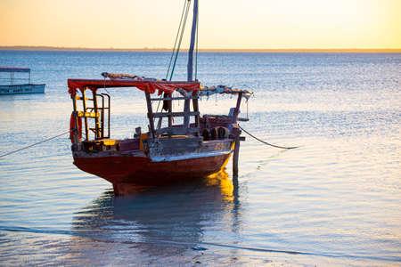 National traditional wooden african boat on the ocean surface at the morning. Coast of island Zanzibar. Tanzania Standard-Bild