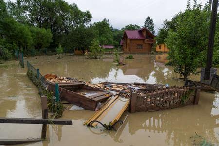 06.23.2020 Yaremche village, Carpathian region, Ukraine. Flooding in village caused by heavy rains. Flooding of houses. Nature disaster